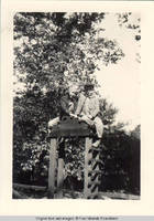 Vidie Burden and Norm Kirch sitting on top of the Playhouse arbor