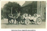 Horse and carriage on Clinton Street with Congregational Church in background, The University of Iowa, 1910s