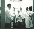 Dental students and instructor examining x-rays, The University of Iowa, September 1954