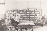 010. Man reading the newspaper at the Fairfield, Iowa Public Library in 1939