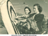 Students retrieving arrows from a target, The University of Iowa, 1940s
