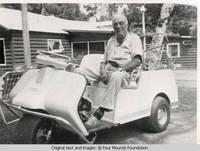 Bill Burden in golfcart
