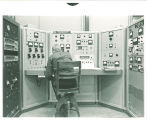 Physics student operating control panel for 5.5 MeV Van de Graaff accelerator, The University of Iowa, 1969