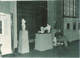 Reading near sculptures in the Art Building, the University of Iowa, October 1947