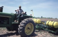 Photograph Collection Of A Man On A Tractor