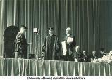 Inauguration ceremony with new University President Eugene Gilmre, left, and former President John Bowman, center, The University of Iowa, October 4, 1934