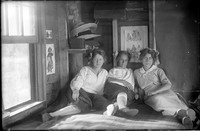 UP 201  Three women on bed in cabin