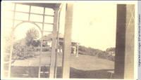 Grey house view through White house rear porch