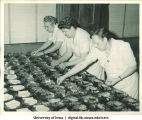 Kitchen workers preparing food for Centennial Dinner, Iowa Memorial Union, The University of Iowa, February 25, 1947