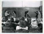 Professor Glenn Murphy illustrates aspects of airplane flight analysis to a class of Curtiss Wright Cadettes, 1943