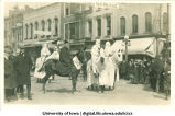 Costumed men on horses in parade, The University of Iowa, between 1910 and 1920