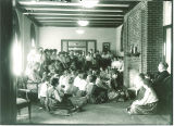 Women gathered in lounge in Currier Hall, The University of Iowa, 1916