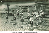 Land drill demonstrating changing paddles with oar straight up, The University of Iowa, 1930s