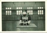 Gymnasts building a human pyramid, The University of Iowa, 1927