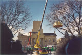 New wood dome with gold leaf being placed on Old Capitol, The University of Iowa, February 24, 2003