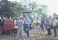 Group looking at farm machinery