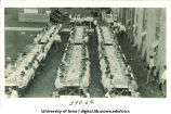 Men dining outdoors at  banquet tables, The University of Iowa, 1910s