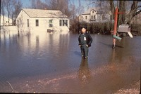 Man stands in flooded area.