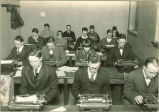 Journalism students working at typewriters in Close Hall, The University of Iowa, 1920s