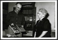James Winston and Georgia Byrne evaluating books about conservation.
