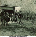 Soldiers coming out of a campus building, The University of Iowa, 1950s