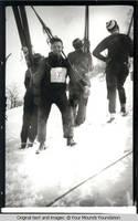 Ski men ascending hill