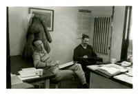 Two Men Around a Desk
