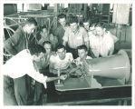 Aerodynamics class examining a model plane, The University of Iowa, 1940s