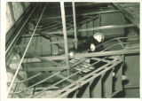 Man descending backstage stairs in Theatre Building, The University of Iowa, 1930s