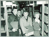 Greeks help shelf books in Main Library during the move in process, the University of Iowa, April 7, 1951