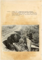 1930's - Man stands in area by road washed out by racing waters