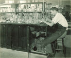 Man working in a laboratory, The University of Iowa, 1930s