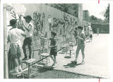 School children painting wall mural, The University of Iowa elementary school, 1960