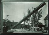 Workmen raising smokestack into position, The University of Iowa, 1890s