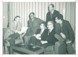 Paul Engle, left, gathered with prominent authors and editors for literary symposium, The University of Iowa, December 4, 1959