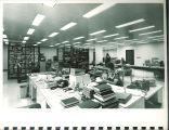 Librarian processing materials at Main Library, the University of Iowa, 1972