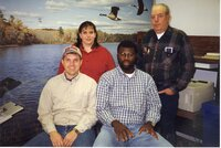 1999 - Office Staff at the Des Moines County Soil and Water Conservation District include: front John White and, J.B. Martin Back Jamie Grimes and  John Horan