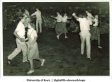 Audience watches couples square dance, The University of Iowa, 1940