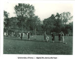 Playing a game outside with a rolling ball, The University of Iowa, 1937