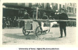 Motorcycle being pushed in parade, The University of Iowa, 1910s