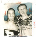Earl Smith and Jerry Reichow after a win against Michigan State, The University of Iowa, September 27, 1954