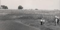 Group of Men Examine Howard Elder's Farm.