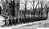 Cadets kneeling with rifles south of Armory, The University of Iowa, 1914