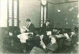 Men in the Unitarian Church reading room, The University of Iowa, between 1910 and 1915