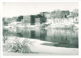 Winter view of dormitories across the Iowa River, the University of Iowa, ca. 1960