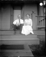 UP432 Man and woman on porch of house number 1005