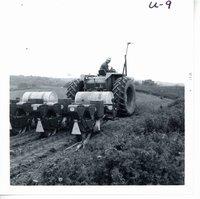 Harold Koch planting corn on strips, 1969