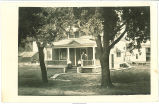 Women and man on porch, Walcott, Iowa, August 22, 1910