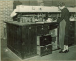 Woman working in a laboratory, The University of Iowa, 1930s