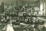 Pharmacy students standing in assigned places in pharmacy laboratory, The University of Iowa, 1910s